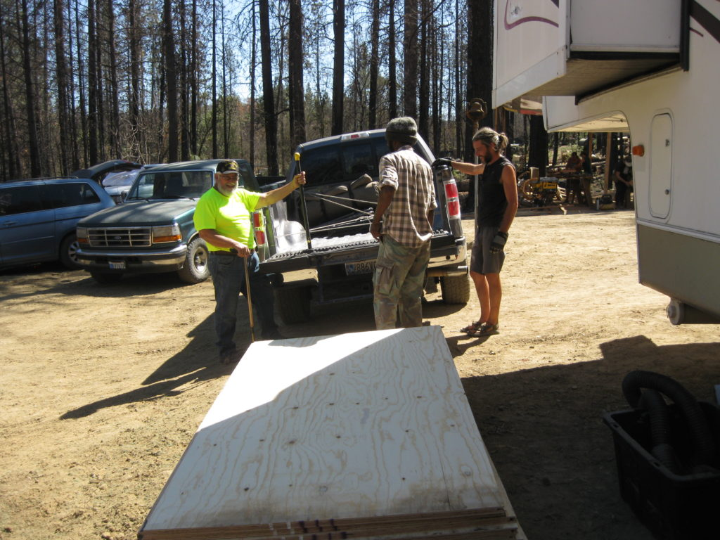 Kip delivering plywood and supplies for the yurt floor at the September 2019 Camp Fire Recovery Project Yurt Workshop.